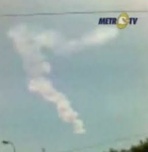 [Remains of an asteroid explosion over Indonesia. Image credit: NASA/Metro TV. From: http://www.msnbc.msn.com/id/33540411/ns/technology_and_science-space/]